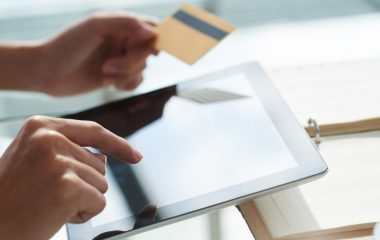 Person paying with credit card for online purchases